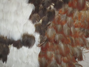Close up view of this Maori quilt made of feathers.