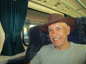 On the train, sporting my new Bahma hat. Life is good.