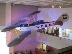 Bi-plane overlooking other Museum pieces.