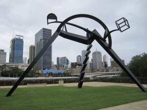 Metal sculpture near the Queensland Museum. Brisbane skyline of in the background.
