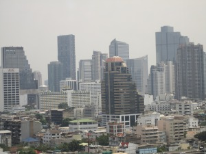 Bangkok skyline. Notice the pollution. It doesn't bother me, but people who are in poor health or smoke, are constantly coughing here. It seemed like all the taxi drivers were doing that. By the by, the taxis are very new, clean, and have excellent air conditioning. Same deal with the trains.
