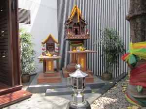 """You will find a Buddhist """"mini"""" temple in all business establishments, e.g., bars, hotels, massage parlors, restaurants, etc. The employees can be found (usually before starting work) praying at one of these temples."""