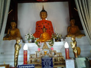 """The sacred Chiang Saen-style Buddha image, called """"Un Mueang."""" The head of the image is hollow and contains holy water."""
