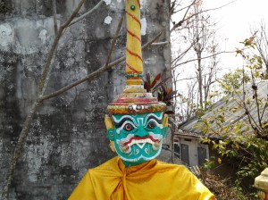 """Scary statue at Mae Yen Buddhist Temple. It was located near these stairs that went down the mountain. I can only imagine that the statues (there were two) """"guard"""" the entrance into the temple."""