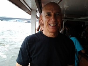 On public boat bus back to hotel. Smiling because the boat was empty and I was relieved to get out of the heat.