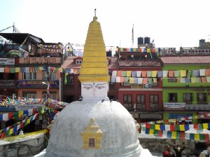 The mandala shaped temple is surrounded by shops, restaurants and other temples.