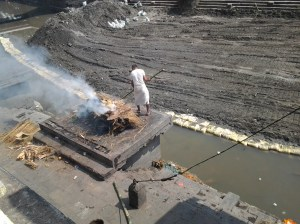 Body being cremated as part of a Hindu holy rite. Not for the squemmish (as I saw a foot still not completely burned on one of the pyres.