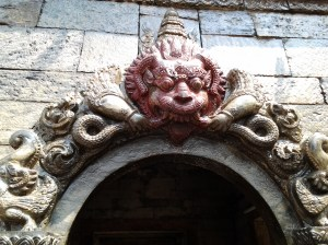 Carving above votive shrine.