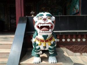 Unusual figurine guarding the entrance into the temple.