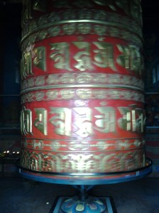 A large prayer wheel which takes 2 people to turn.