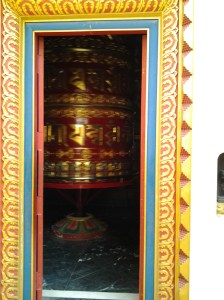Prayer wheel observed from outside the entrance.