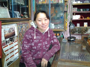 Chhiring Sherpa, who runs a small shop. I bought a small gold Tibetan Om medallion from her and she threw in a small hand made bag, that Nepalese and Tibetan people normally use for carrying their money.