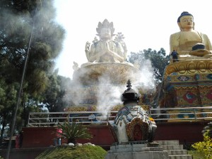 One of the three Buddha. Incense burning below the statue.