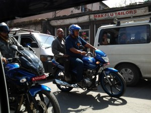 The preferred mode of transportation in Kathmandu is a motorcycle.
