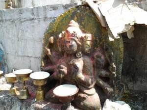 Buddhist figure at the base of the Stupa.