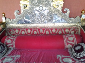 Some sort of palace sofa that was in a glass room. However, they were doing periodic housekeeping and had the glass door open and allowed us to take a couple of photos (without the glare).
