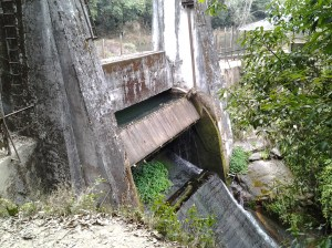 Concrete dam and mechanical spillway.
