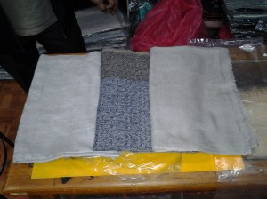 I ended up buying the 2 shawls and a muffler. The light colored one on the far left is the highest quality; the one on the far right, a bit below that; and, the muffler in the middle significantly lesser quality (which is the one I am keeping). Again, the quality has little or nothing to do with the craftsmanship or how they are made. It has everything to do with the material used to make the shawl or muffler.