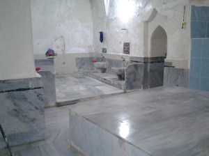 "The marble ""table"" in front is where the massage takes place. The marble floor in the background is very, very hot. I was told to lie down on it and it took me a while to lie prone on it. I felt like a lobster thrown in boiling water or perhaps, a lamb chop placed on a frying pan.  Ha."