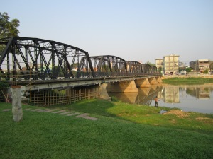 Chiang Mai bridge. Notice the fisherman to the right.