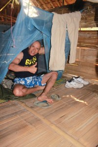 Me getting familiarized with my mosquito netting and bamboo mattress. Notice my pants hanging down? Everything I wore was drenched with a combination of sweat and water. Ditto for socks and shoes.