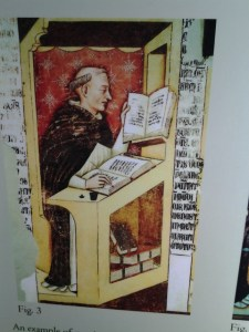 A poster showing a monk working on a theological manuscript.