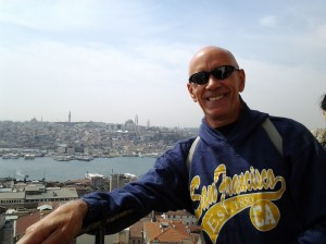 On the Galata tower in Istanbul, Turkey, with the Bosphorus Strait in the background.