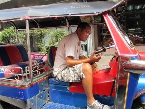 Tuk tuk driver in Bangkok, Thailand.