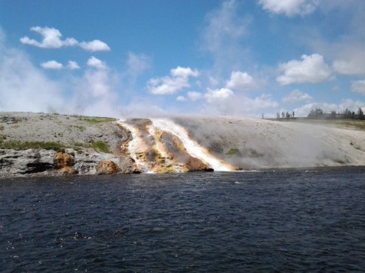 Boiling stream of water feeding into the river.