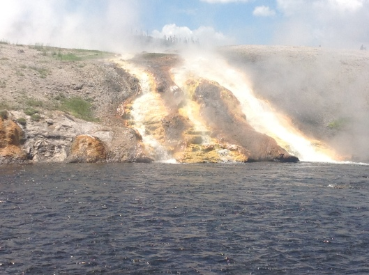 Boiling water feeding a river at Yellowstone.