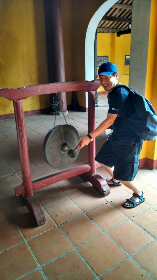 Ralph trying out a gong we found in Quang Trieu (Cantonese) Assembly Hall.