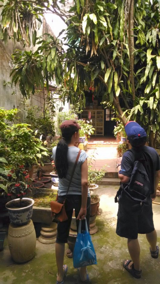 Thao and Ralph in the courtyard of one of the old residences.