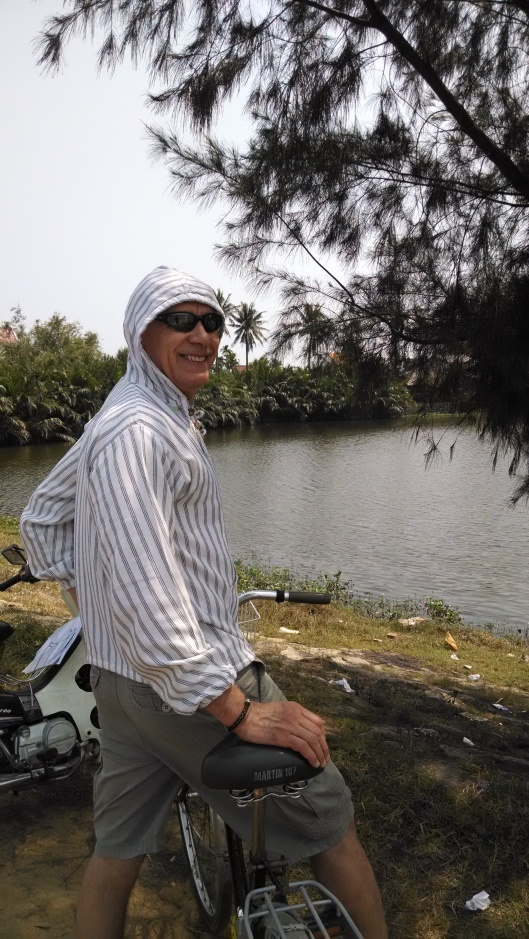 We took our bikes to the beach, but it was quite hot out and took a break under a tree.  Actually, Hoi An is mild compared to Ho Chi Minh. Nevertheless, you should cover all parts of your skin as the Vietnamese do. You will rarely see them go out without long sleeves and a head cover.