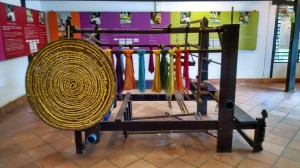 Loom for weaving silk. Notice the circular (upright) basket? This is where the silk worms are placed.