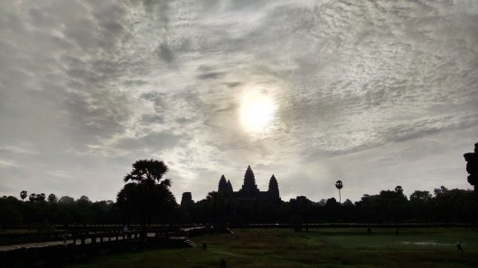 Sun rising over Angor Wat.