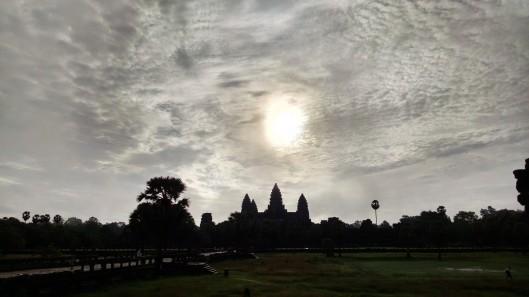 Sun rising over Angor Wat.