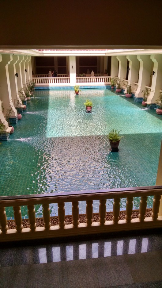 Pool and fountain surrounded by galleries.