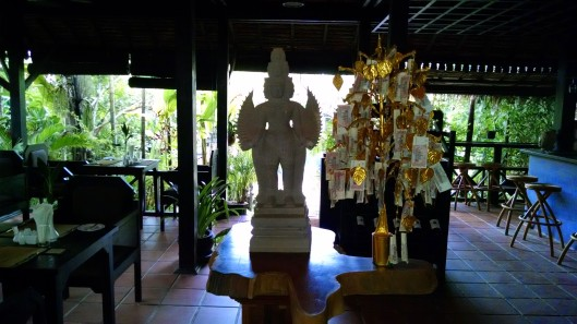 """Buddha, along with """"lucky"""" gold money tree. All business establishments in S.E. Asia will have a Buddha (temple) placed in their establishment for the workers to pray. They usually do this before the start of their work day."""