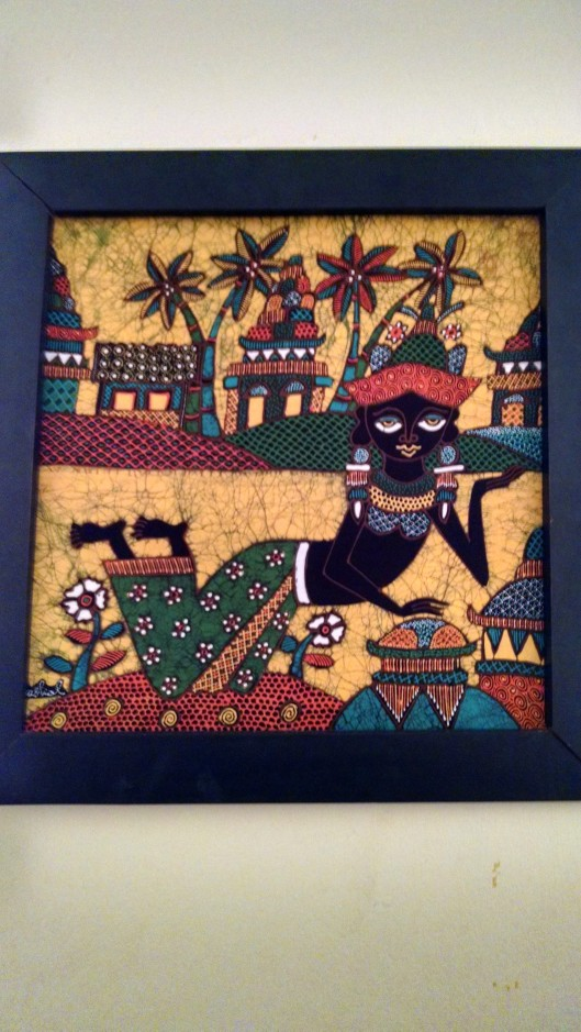 """This is called a """"Batik"""" painting. The painting is done on cloth in stages, i.e., first an outline, then each individual color is added. I wanted to buy one in the gift shop, but they were over $100."""