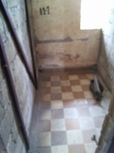 Prison cell. Empty ammo box was used by the prisoner to defecate in.