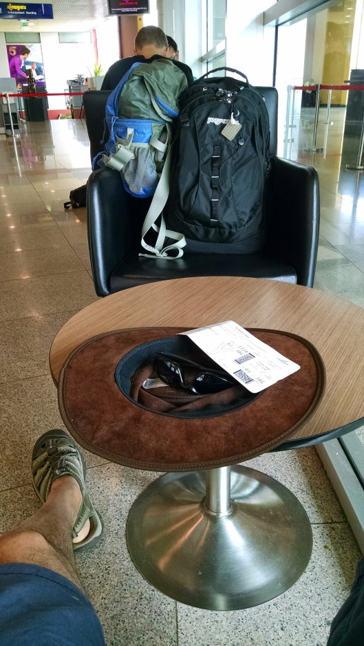 Waiting in the Phnom Penh airport to board my plane to Luang Prabang, Laos. All my gear for the next few months is in the opposite chair. Yes, I travel light.