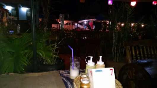 Watching the world pass by during dinner at a restaurant in Luang Prabang.